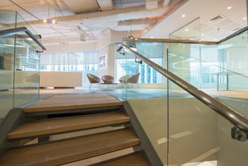 The American White Oak staircase … connects the various sections of the head office building.