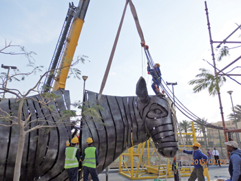 Workers putting together one of the sculptures.