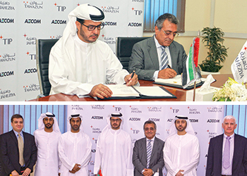 Tawazun and Aecom officials at the agreement signing ceremony for Jaheziya city.