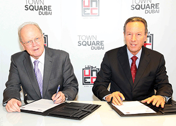 Durie and Muwahid (right) sign the agreement for the construction of Town Square apartment blocks.