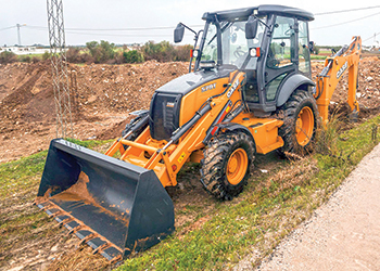The Case 570T backhoe loader.