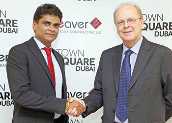 Krishna (left) and Durie shake hands on the deal.