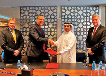 Zaghw and Al Shaer shake hands after signing the agreement.