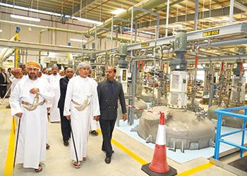 Officials tour the new plant.