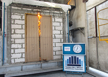 A fire resistance test... conducted on a door.