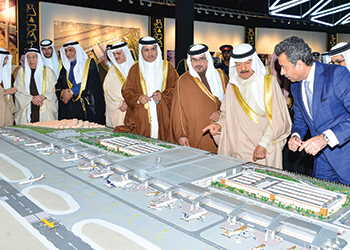 The Premier looks at a model of the airport project.