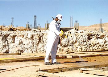 A Masa operator treating termite infestation.