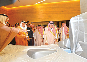 King Salman looks at a model of the King Abdulaziz Centre for World Culture.
