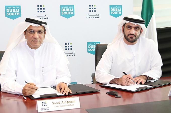 Deyaar and Dubai South officials sign the agreement.