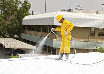 An operator applies CRRC to a roof.