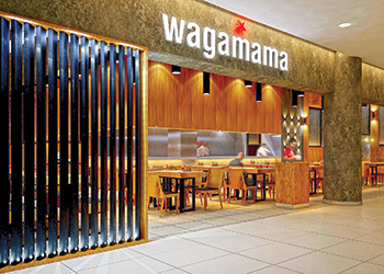 wagamama at the Red Sea Mall ... more communal seating and fewer screen dividers.