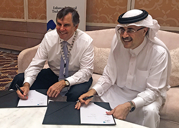 Collaboration ... Farr and Nasser sign the agreement.
