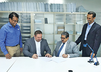 MH Al Mahroos and Genie officials sign the deal.