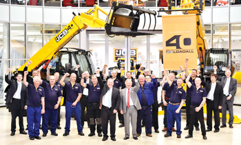 JCB chairman Lord Bamford and Loadall managing director Ian Pratt celebrating the  40th anniversary of the JCB Loadall with colleagues.